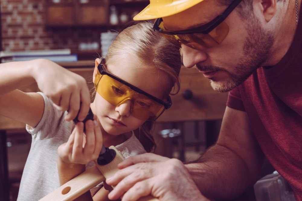 Girl and father building together