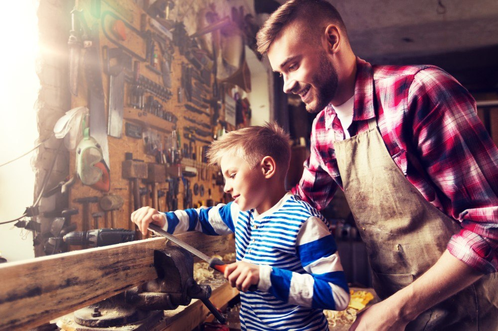 father and son working together in workshop