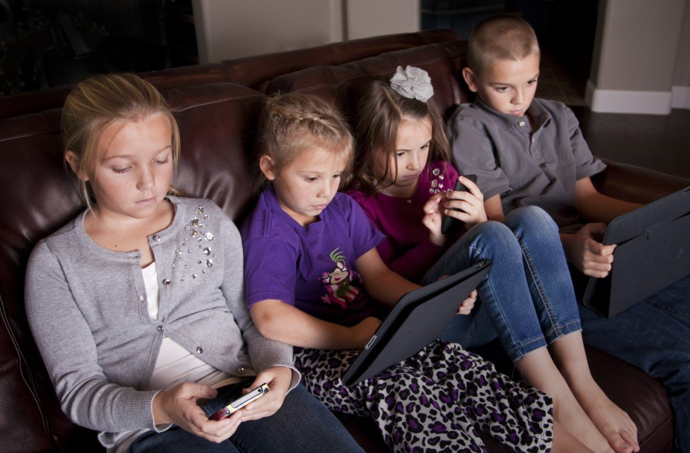 Kids watching screens at night time